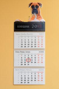 Квартальный календарь стандарт с пластиковой шапкой и УФ печатью.